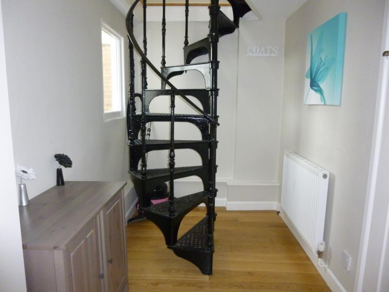Spiral staircase. There are also wooden external stairs to enter the house from the beach side.
