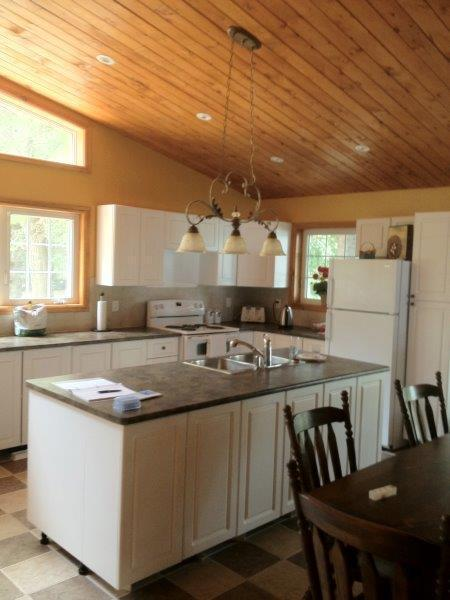 Huge kitchen with centre island, large fridge, double ovens and dishwasher - lots of storage too!