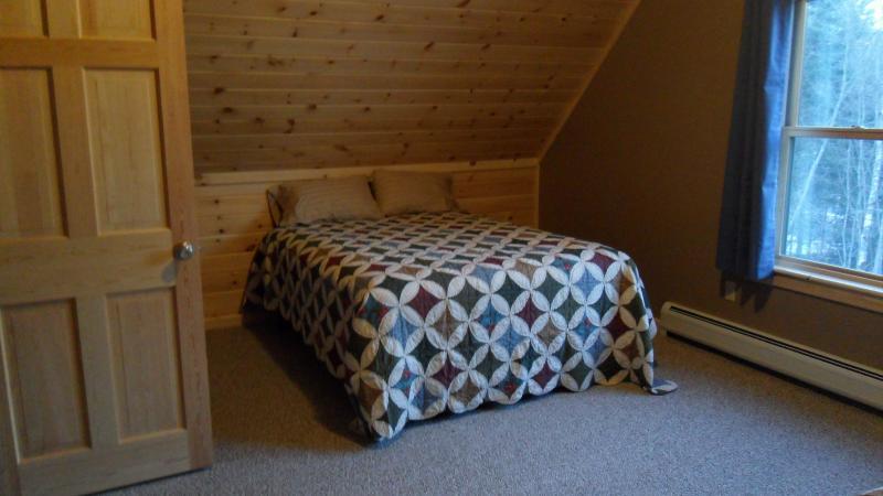 One of Two Queen Beds in Bedroom 2