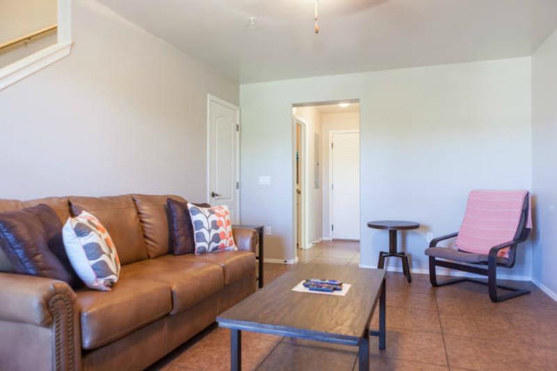 Living room w/ 40' HDTV, queen size sleeper sofa w/ memory foam mattress