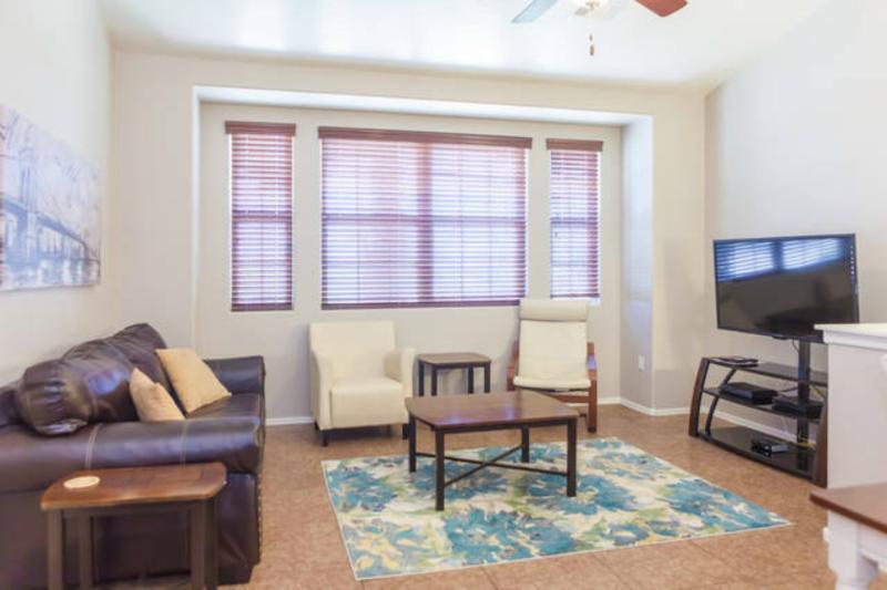 Family room with HDTV, full size sleeper sofa w/ memory foam mattress
