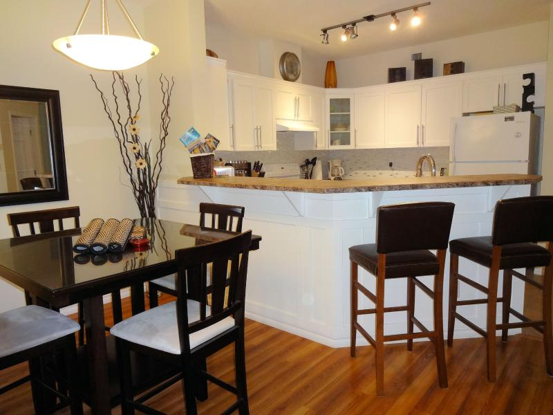 Bright and inviting 1030 sq. ft pool level walk out