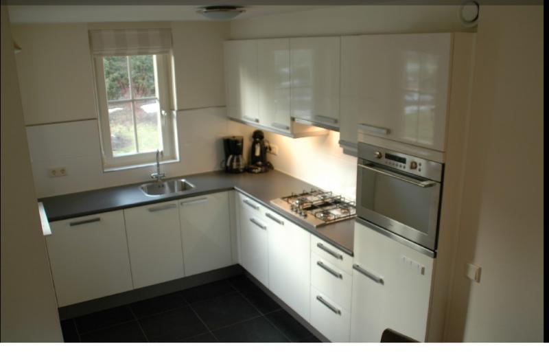 Modern kitchen with microwave, dishwasher etc.