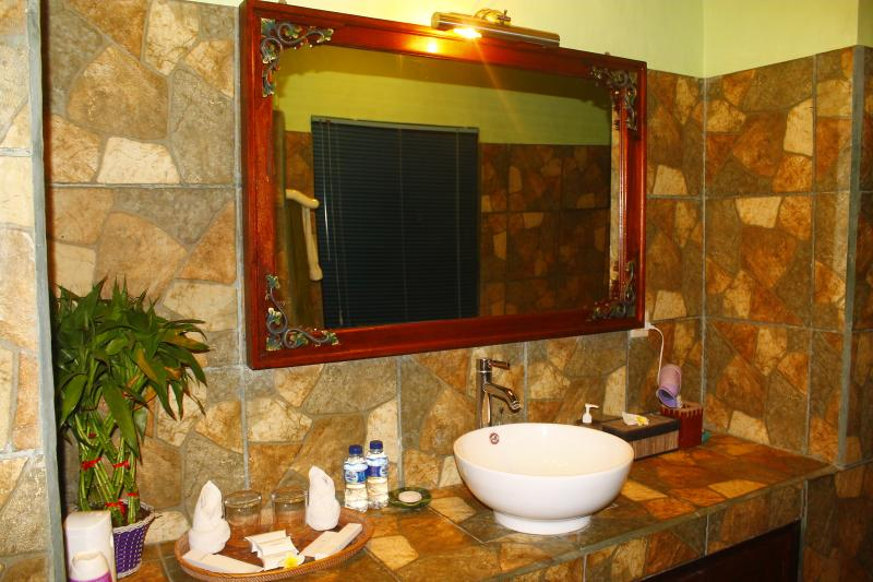 hot and cold water in wash basin,hair dryer, and another amenities in bathroom