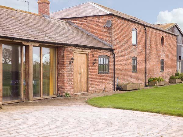 THE BARN, superb family holiday home, en-suites, plenty to see and do in the, holiday rental in Burlton