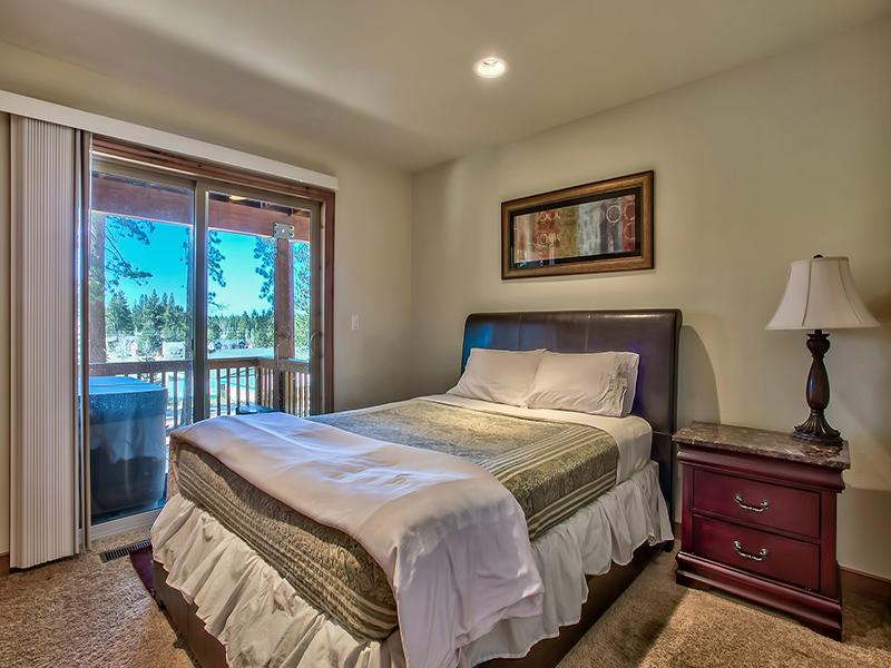 Lower level bedroom with queen bed and access to hot tub located on balcony.