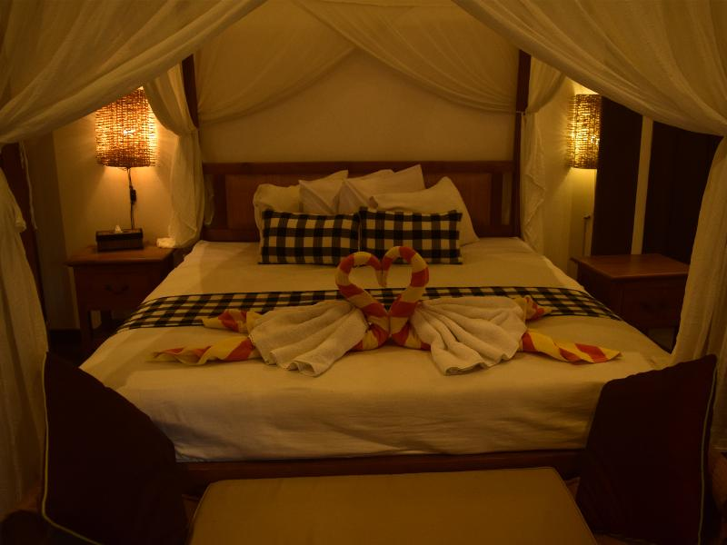 A Balinese crafted four-poster bed awaits your tired soul with a comfy-feel-at-home atmosphere.