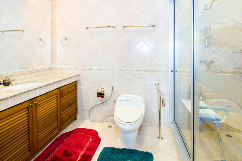 View on toilette with help for handicapped people and separate shower room with cold and hot water