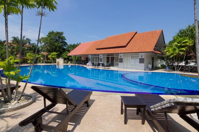 Common salt water swimming-pool of the private resort View Talay Villas with restaurant and bar