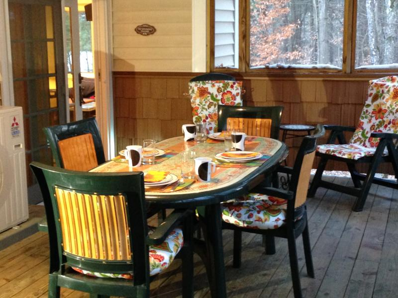Huge porch - gather around the table - or just relax and chat.