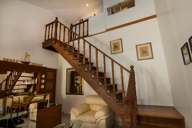 Stairs leading up to the second floor of our property to the Top-guestroom 404/69