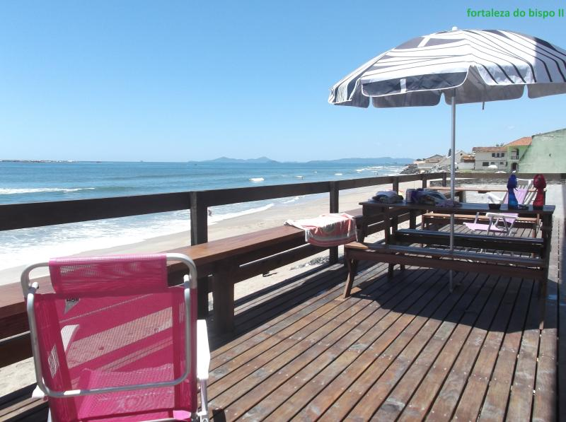 wooden deck beside the beach, pe on the sand