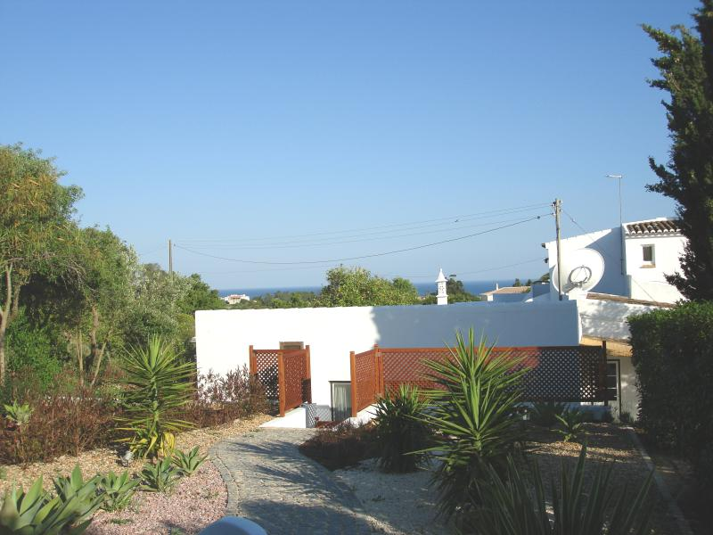 Cottage apartment private and secluded garden with olive trees and a view of the sea.