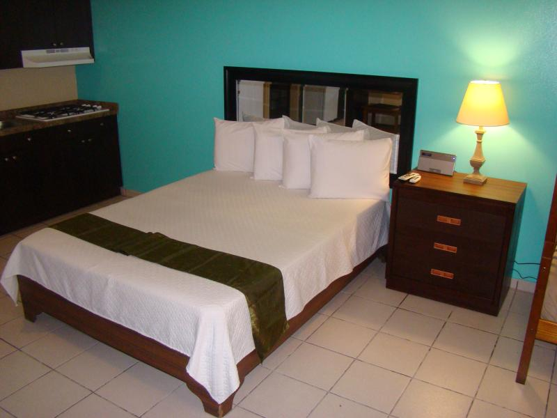 Queen bed with night stand and Alarm Clock Radio