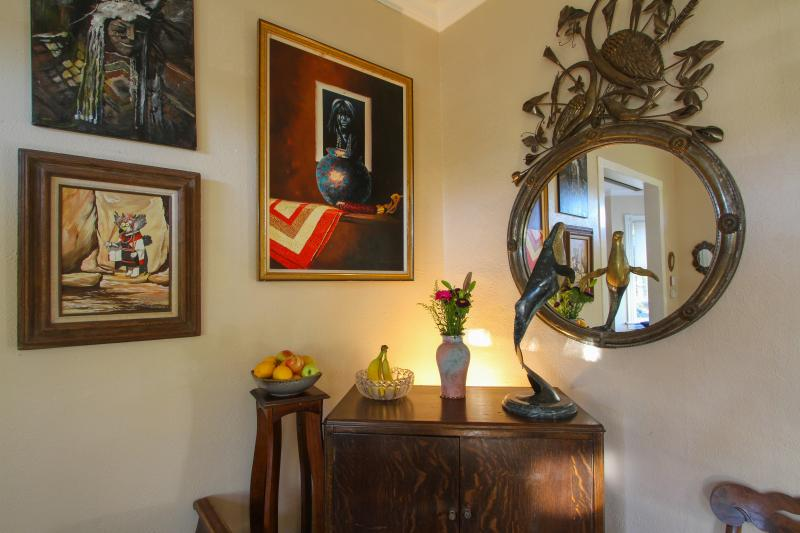 An art and antique filled parlor.