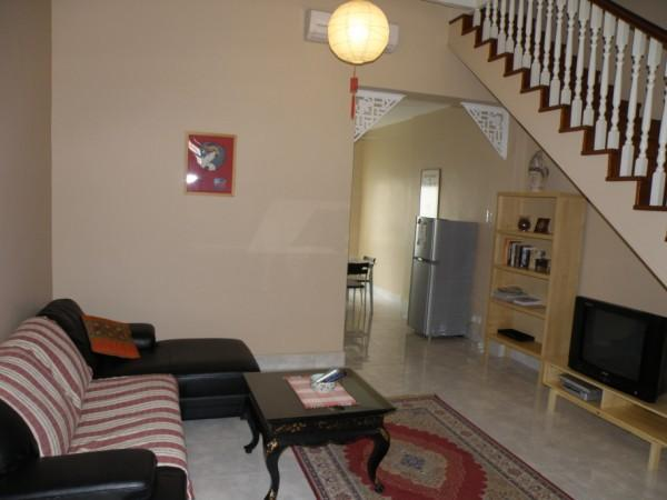 Living area, with air-conditioning and ceiling fan. LCD TV and DVD player for entertainment.