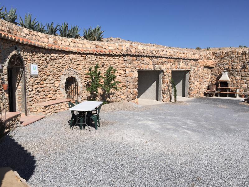 Facade, garage and outdoor barbecue.