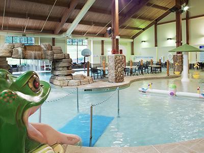 Indoor pool with slides, waterfall, and kiddie splash area.