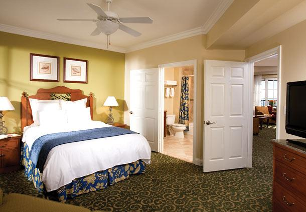 Master suite with king-size bed, luxurious oversize soaking tub, separate bath with twin showerheads