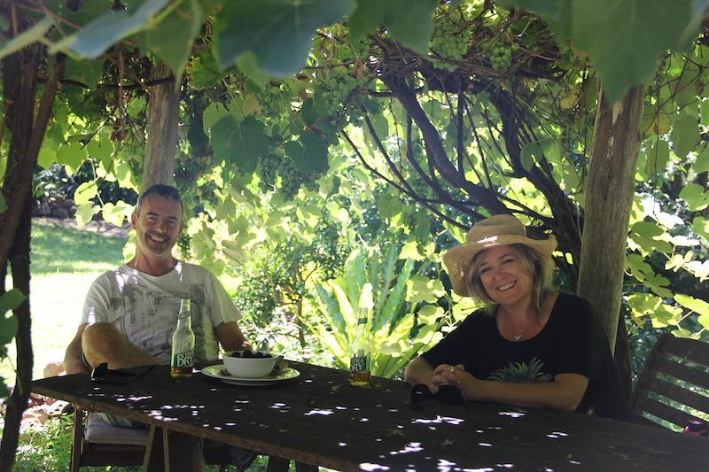 Relax under our grape arbour  for your meals and enjoy the garden