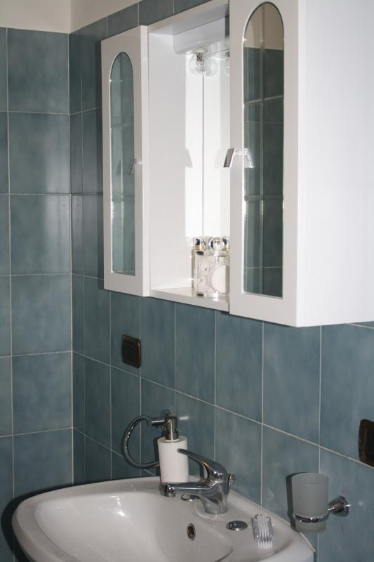Bathroom, including bath with shower over, toilet and bidet.