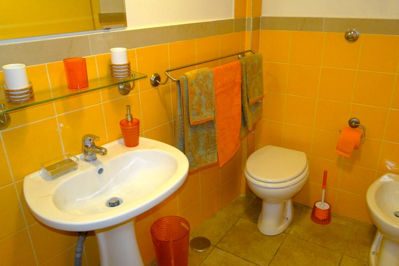 Bathroom with wc, bidet, and box shower