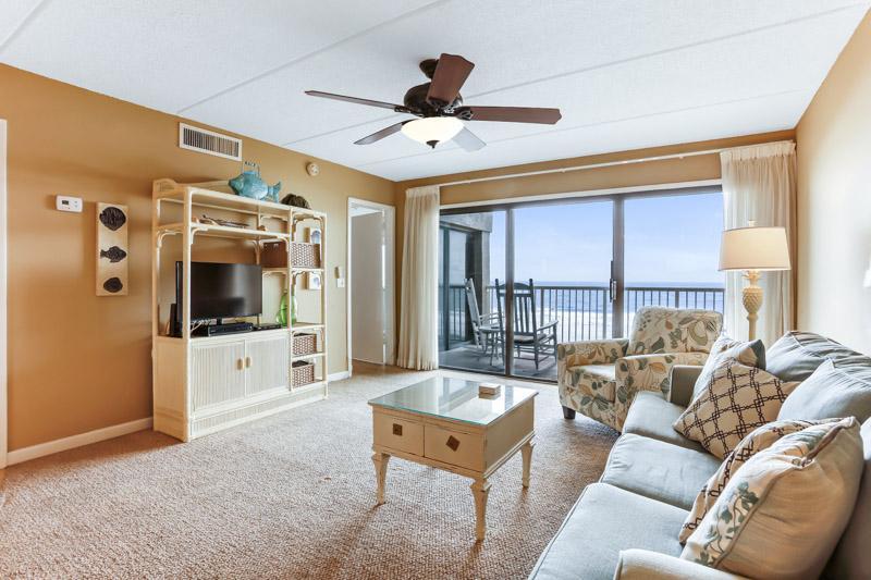 Couch,Furniture,Floor,Flooring,Entertainment Center