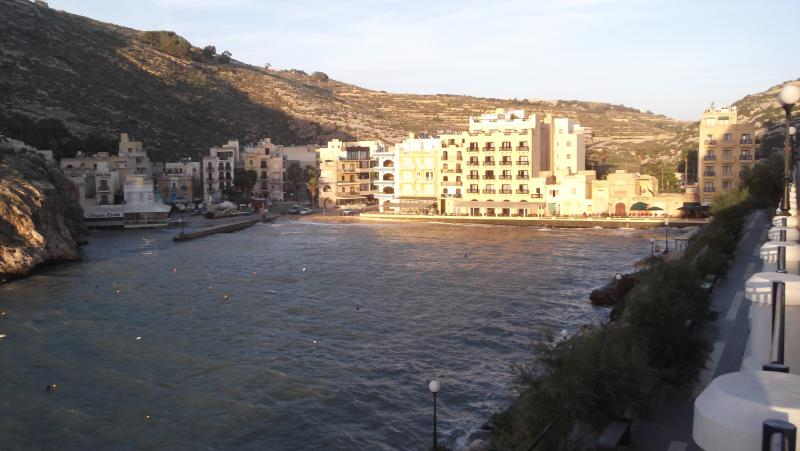 Xlendi Bay and village