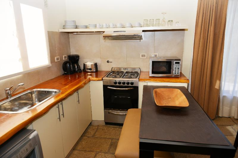 Open concept kitchen.  Full self catering facilities include oven,4  burner stove microwave, coffee