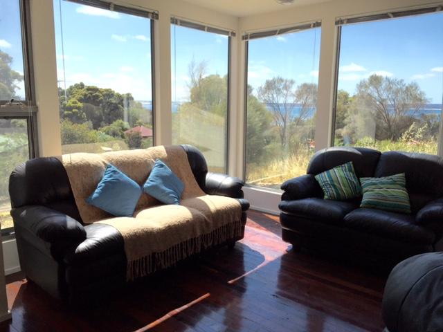 Lounge area with comfy chairs and views of eastern Cove seaside plus up the valley.