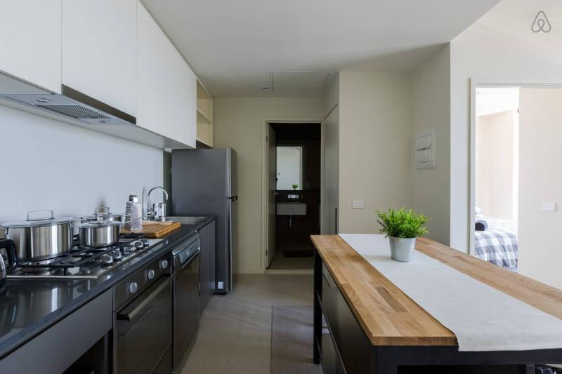 A fully decked & equipped kitchen/dining area.