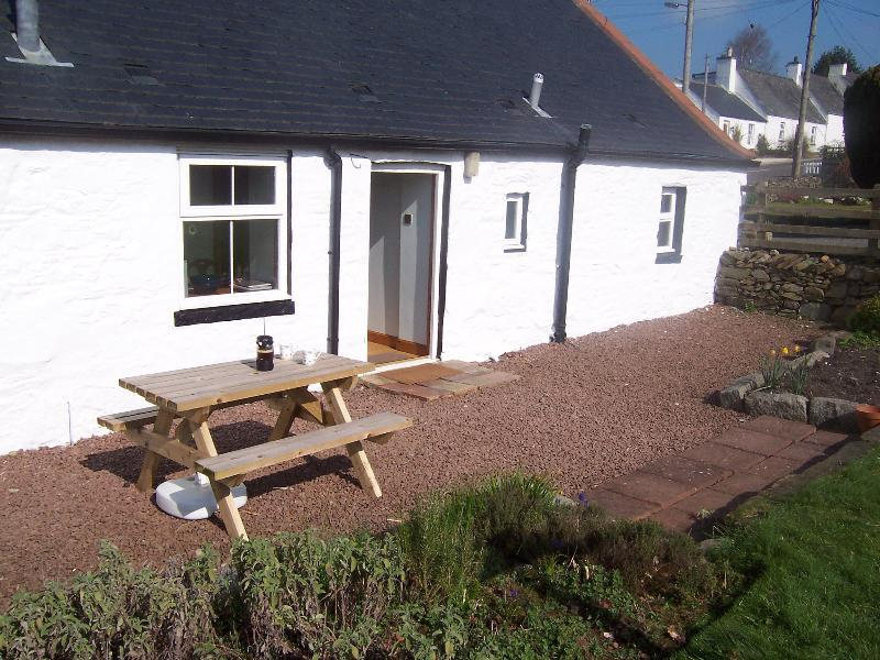 Picnic table outside Glenfinart Cottage back garden