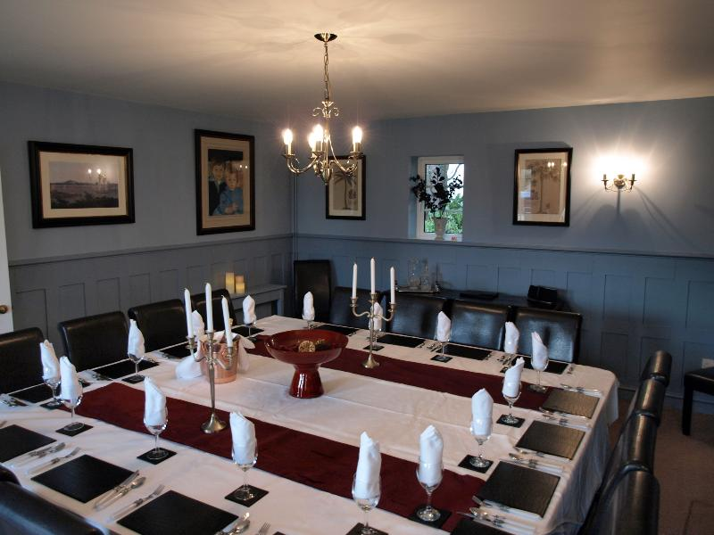 Stunning panelled  dining room to seat 20 .