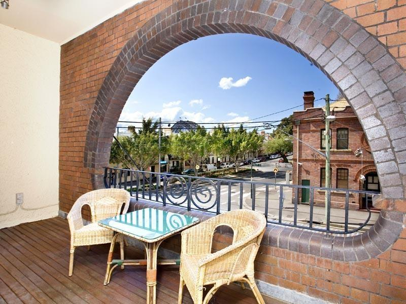 Large main balcony w views to the Sydney Harbour Bridge (please note we now have 6 person wicker set
