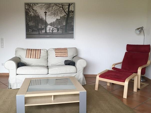 Sitting area with 2 seater sofa and rocking chair