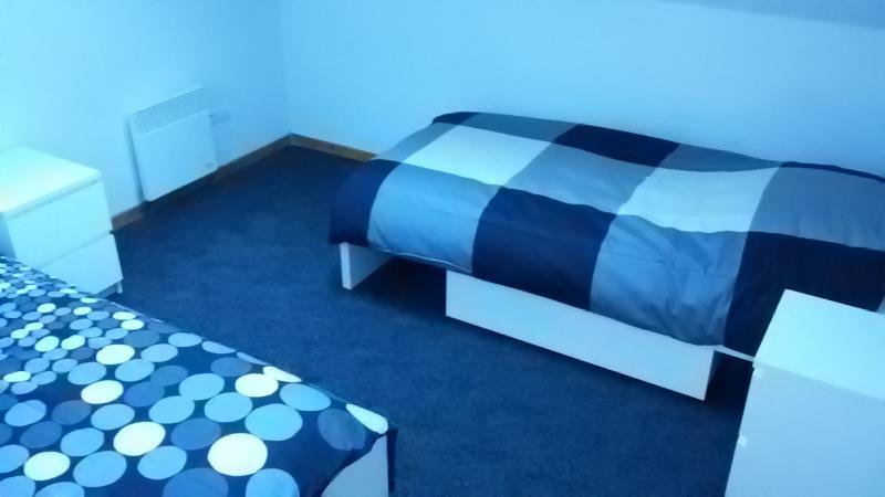 La chambre avec les 2 lits simples