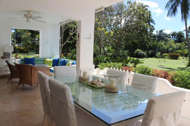 Spacious patio with direct access to pool, lovely garden and pool views