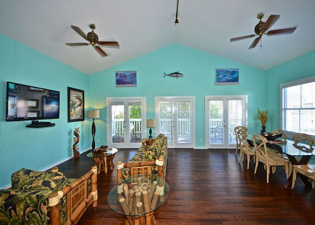 Wide open living area with welcoming accents and vaulted ceilings