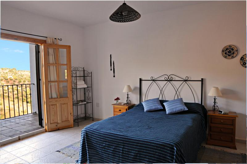 Large master bedroom with en-suite shower room and built in cupboards.