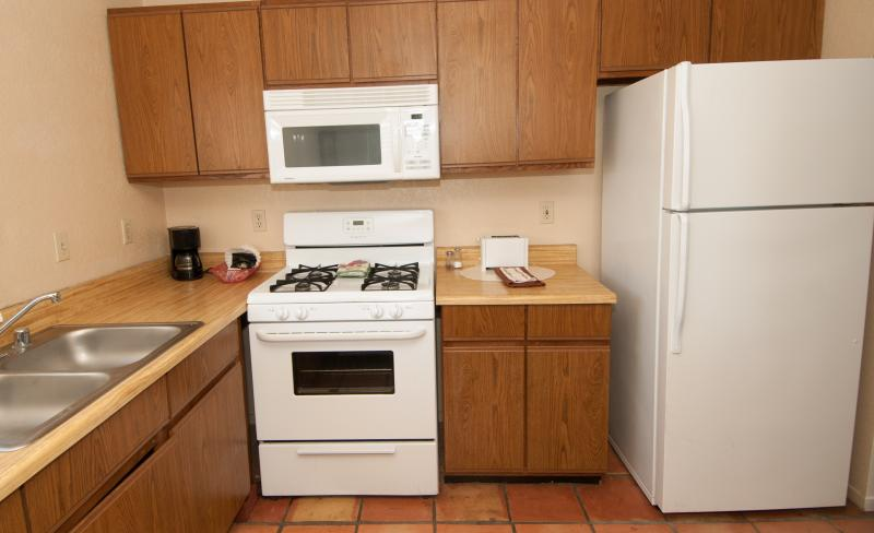 Kitchen includes stove, oven, microwave