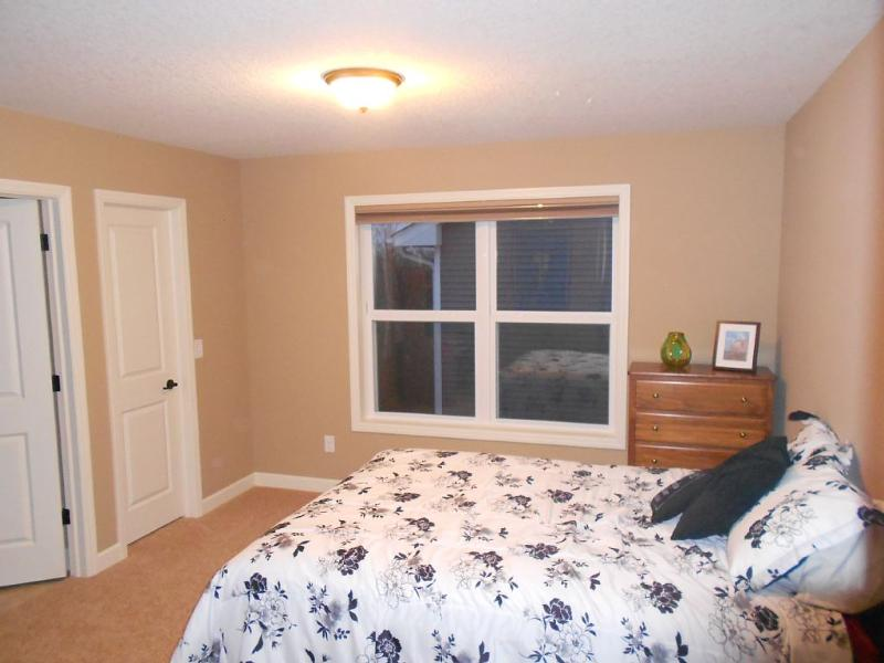 Upstairs guest room with queen bed and attached 3/4 bath