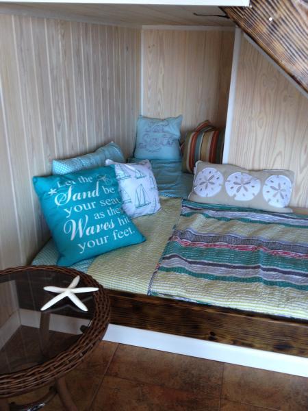 Bed nook under stairs