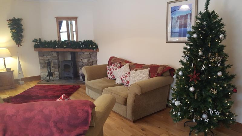 Light the log fire to create a cosy setting