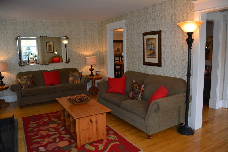 Living room with plenty of comfortable seating, fireplace and TV/BluRay