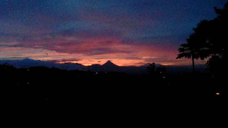 A lovely sunset shot of Arenal Volcano as taken from the property.