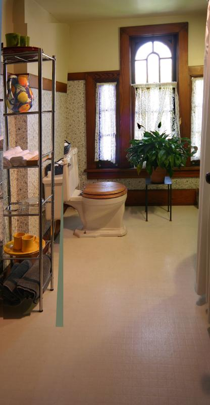 Full bath with clawfoot tub/shower and pedestal sink.