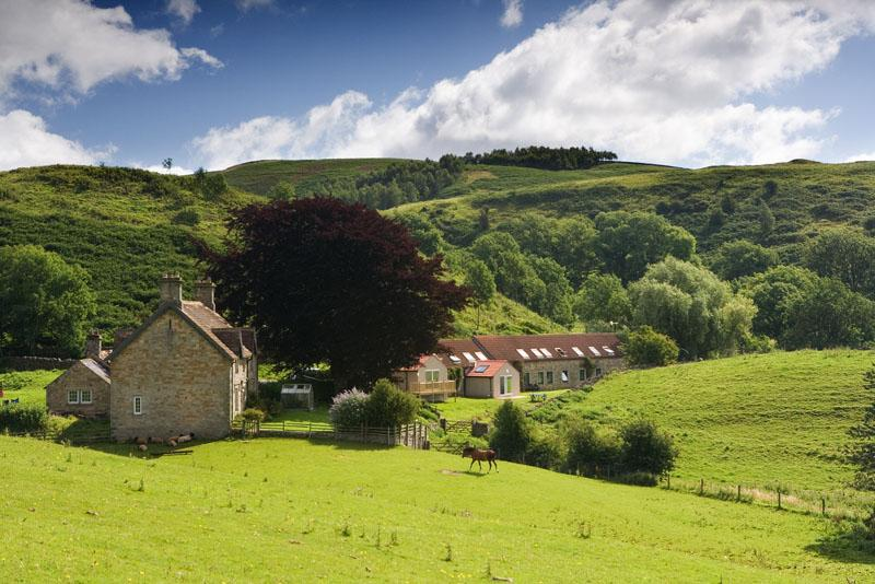 View of the farm, Talkin Head and the cottages Long Byres.