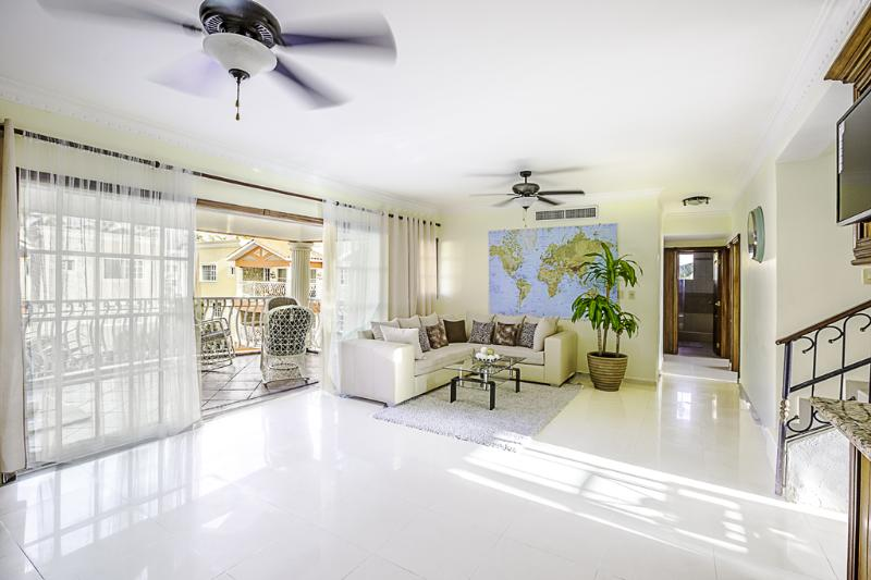 On the first level, you'll find a large living room with a spacious patio overlooking the pool.