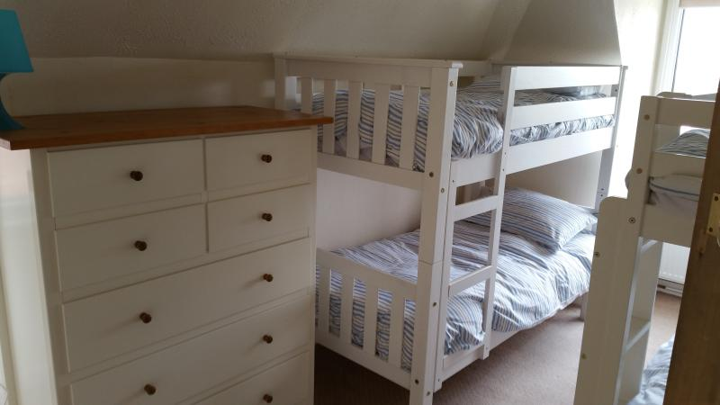 Upstairs second bedroom with two sets of bunk beds