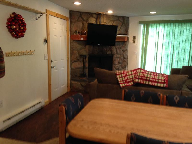 Dinning area with seating for 6, comfy couches and plenty of hooks for coats and gear